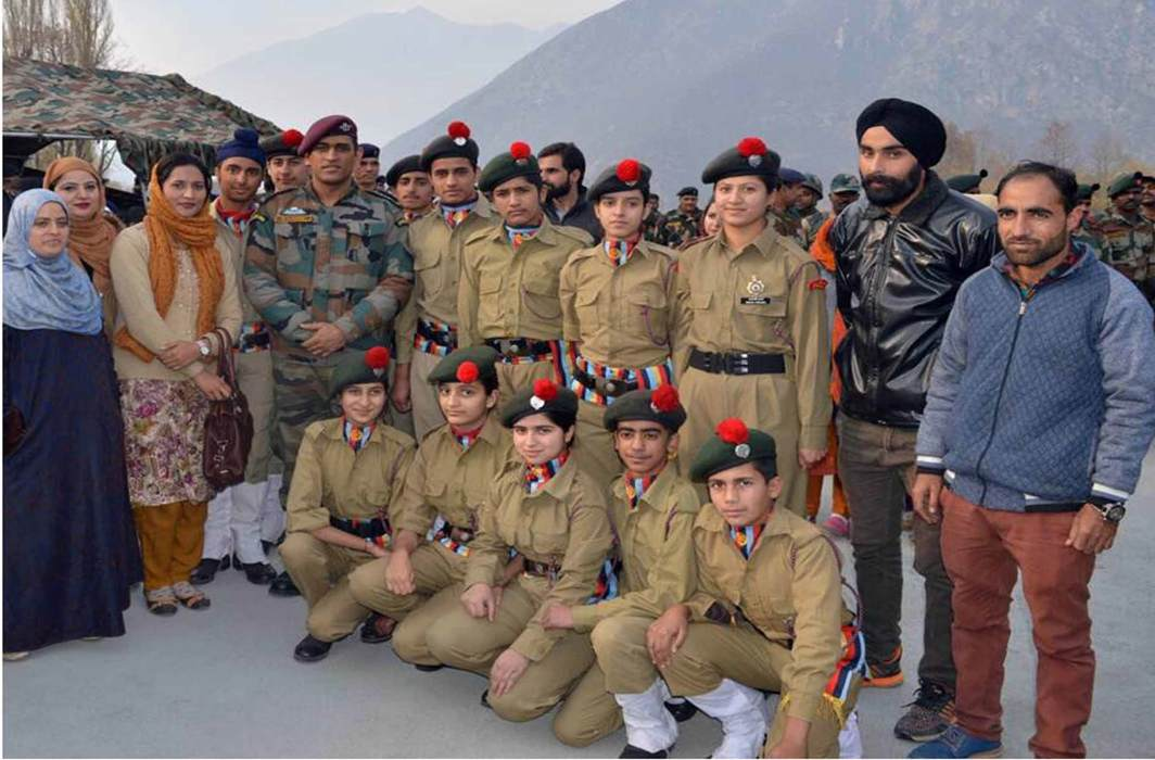 ROLE MODEL: Former Indian cricket captain MS Dhoni in a group photograph with NCC cadets at the border town of Uri in the north Kashmir district of Baramulla, UNI