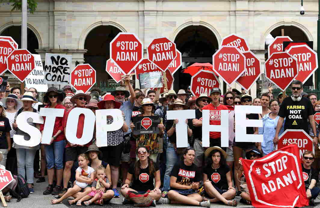 THREAT FROM INDIA: Anti-Adani protesters protest outside Queensland's Parliament House in Brisbane, Australia, Bradley Kanaris/AAP/Reuters/UNI