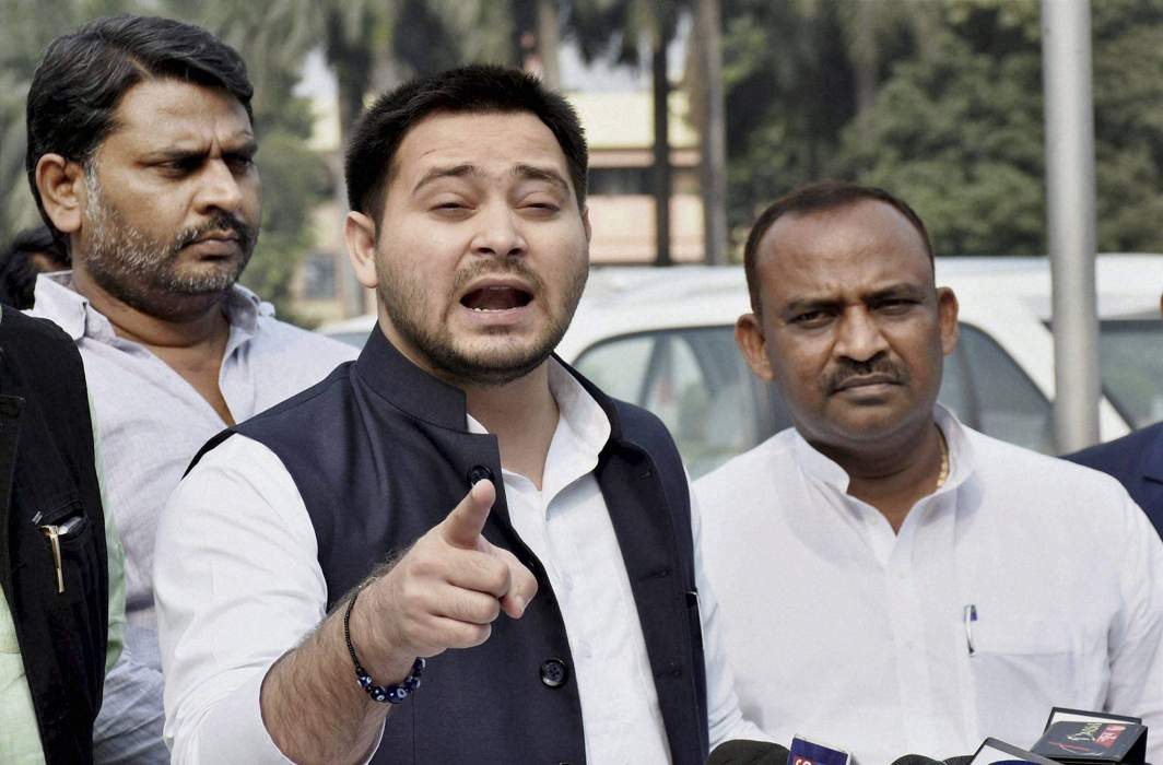 New low: JD (U) releases Tejashwi Yadav old picture with a girl and liquor bottle in backdrop