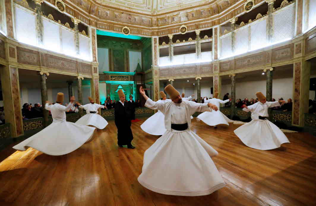 "DANCE OF THE DEVOUT: Whirling dervishes perform a ""sema"" ritual during a ceremony, one of many marking the 744th anniversary of the death of Mevlana Jalaluddin Rumi, at Galata Mevlevi Temple in Istanbul, Turkey, Reuters/UNI"