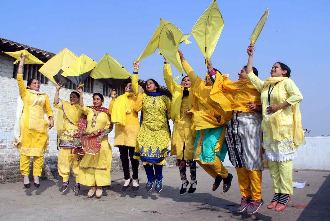 LEMON RIOT: Teachers dressed in Basanti clothes fly kites during Basant Panchmi festival at a school in Amritsar, UNI
