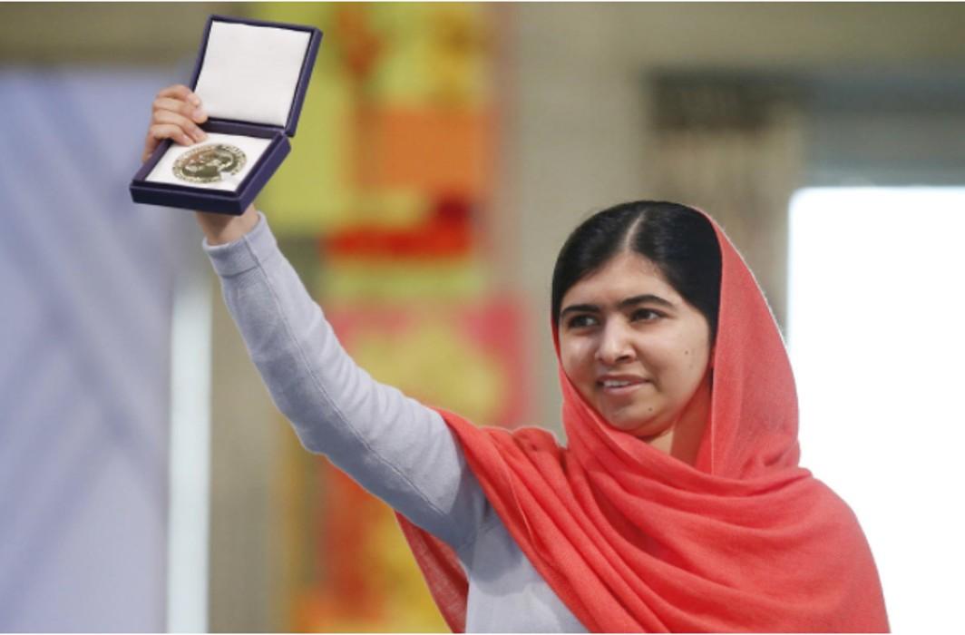 Malala returns to Pakistan, meets PM Khaqan Abbasi