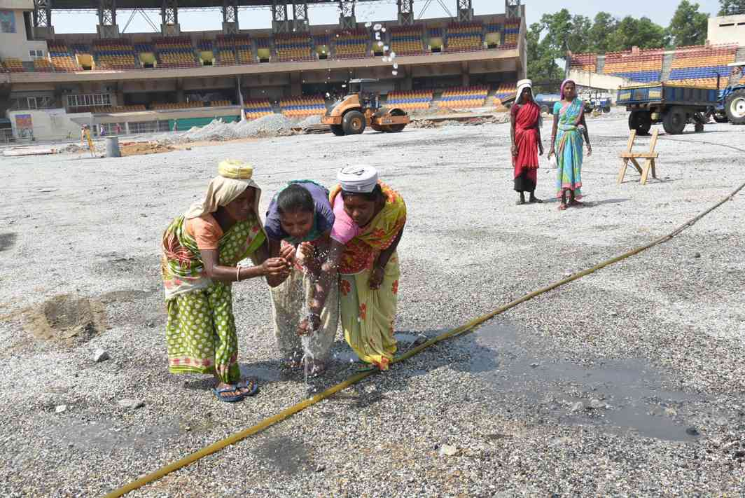 SIPS OF ENERGY: Female workers quench their thirst on a hot summer day at a construction site in Ranchi, UNI