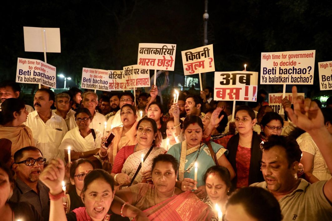 FIERCE OUTCRY: Congress activists participate in a candlelight vigil in protest against the Unnao rape case at India Gate, UNI