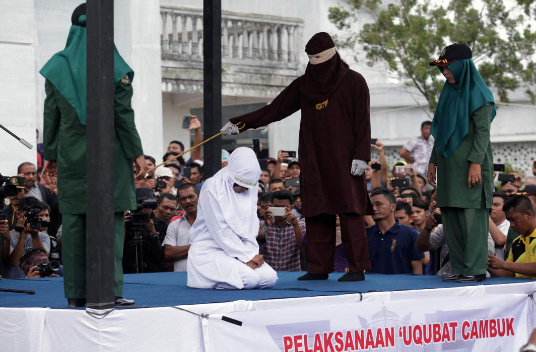 An Indonesian woman is publicly caned for prostitution in Banda Aceh, Aceh province, Indonesia, Reuters/UNI
