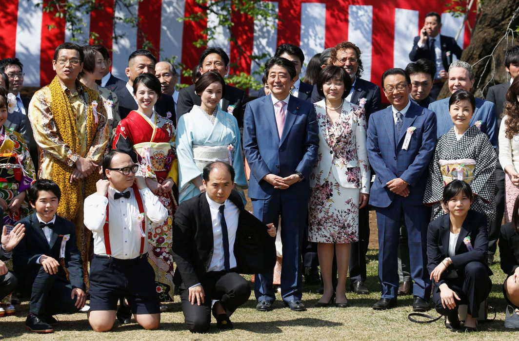 Japanese Prime Minister Shinzo Abe (centre) and his wife Akie (right of Abe) pose with showbusiness celebrities at a cherry blossom viewing party at Shinjuku Gyoen Park in Tokyo, Japan, Reuters/UNI