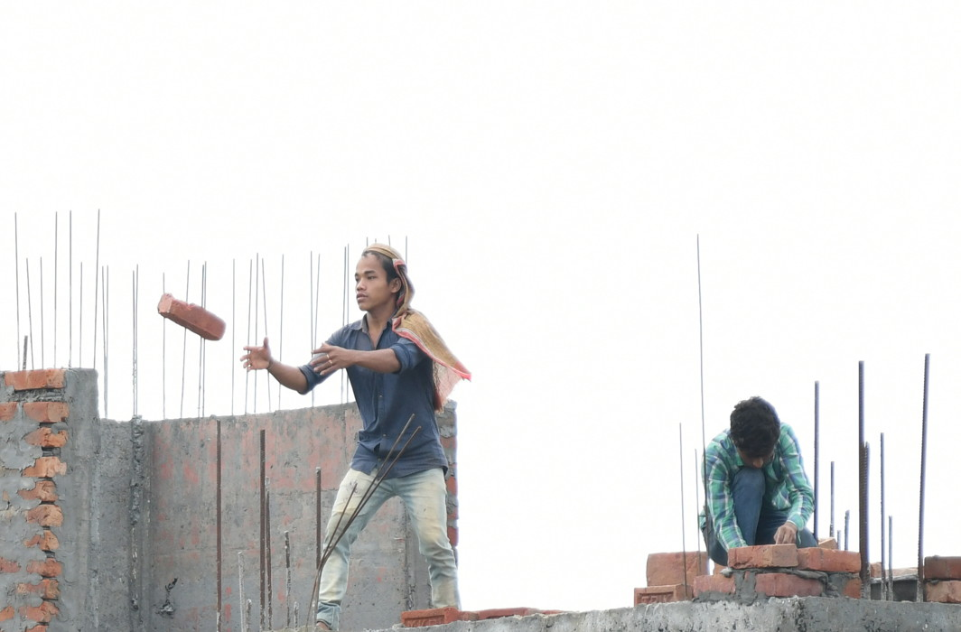 Labourers work at a construction site in Agartala, as International Labour Day is celebrated worldwide, UNI
