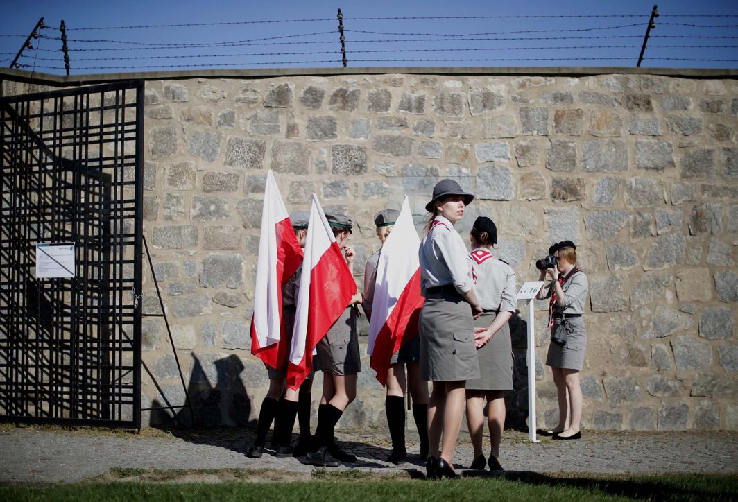 Scouts from Poland stand at the memorial site of the former concentration camp Mauthausen ahead of the commemoration ceremony of liberation, Mauthausen, Austria, Reuters/UNI