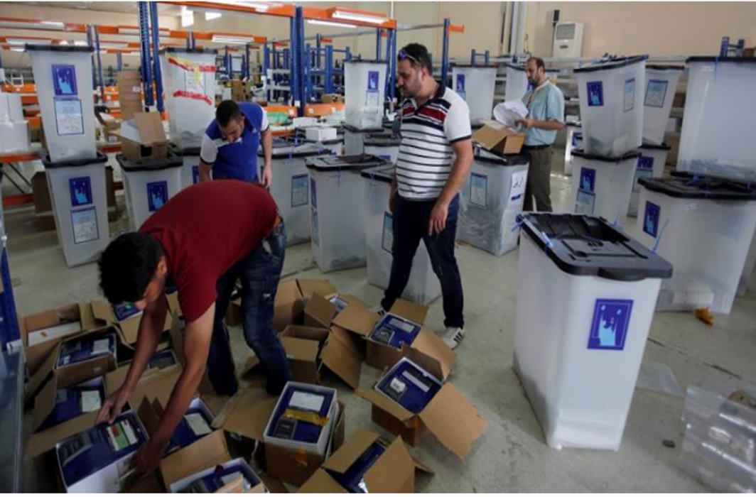 Iraq audits EVMs, orders manual vote count