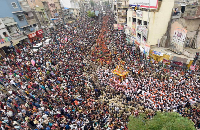 People participate in the 141st Jagannath Rath Yatra in Ahmedabad, UNI