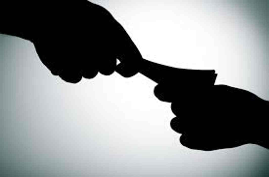 Changed anti-corruption law tightens rules for prosecuting officials, penalises bribe givers