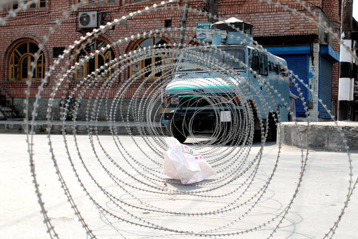 A security bunker vehicle stationed and concertina wire barricades placed on Kawdara on Nalla Mar road as authorities clamped curfew-like restrictions in parts of Srinagar following general strike called by Joint Resistance Leadership against attempts to abrogate Article 35A, UNI