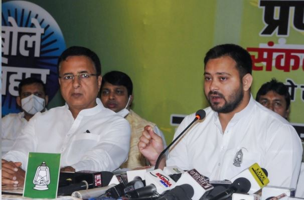 Tejashvi Yadav and Randeep Surjewala