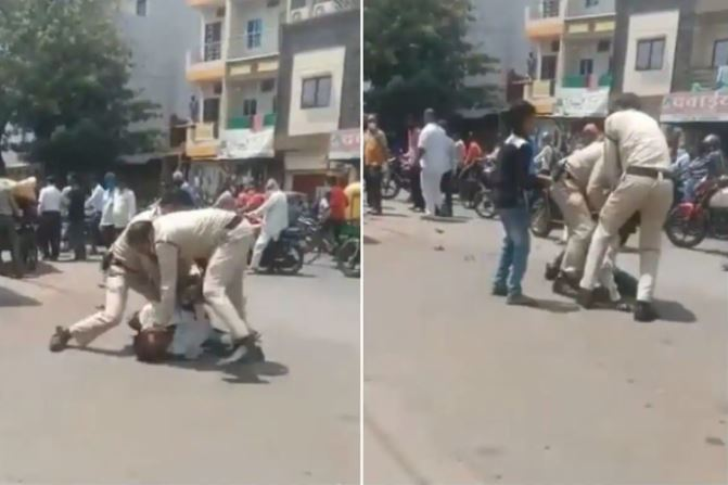 Policemen in Indore beating a man for not wearing