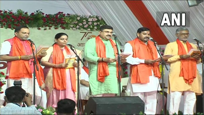 oath-taking ceremony of newly appointed ministers in the new cabinet at the Raj Bhawan in Gandhinagar