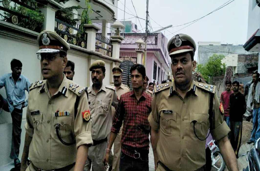 Murder of two daughters of retired army man and killer arrested.
