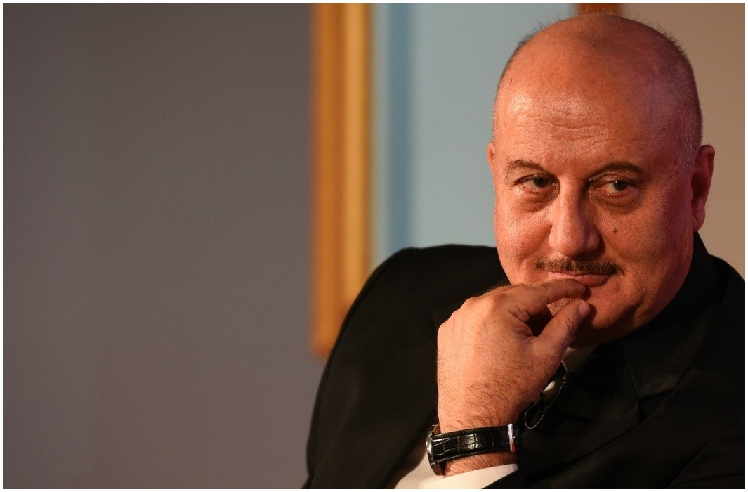 anupam kher said can stand in long queues in cinema but not for the national anthem