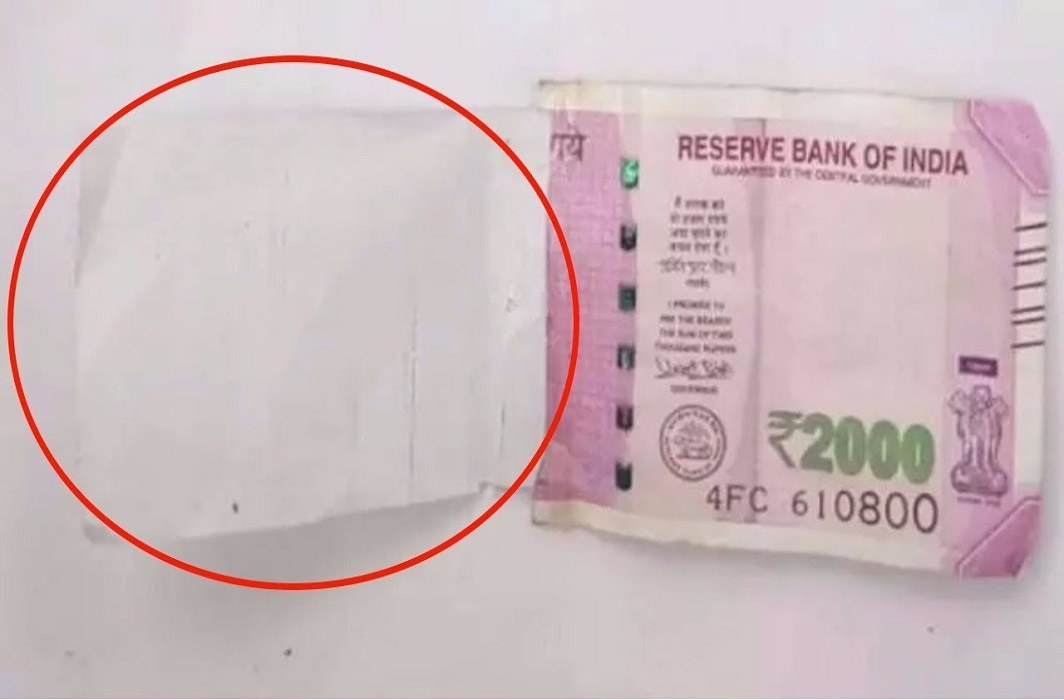 Half of Rs 2000 rupee note from ATM, bank refuses to take responsibility