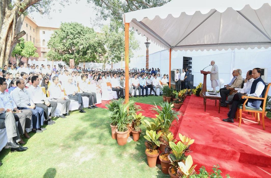 pm narendra modi interacts with pmo staff post lok sabha election results